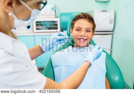 Small, Young Patient Boy Is Happy With A Visit To The Dentist. Concept Of Painless Dental Treatment.