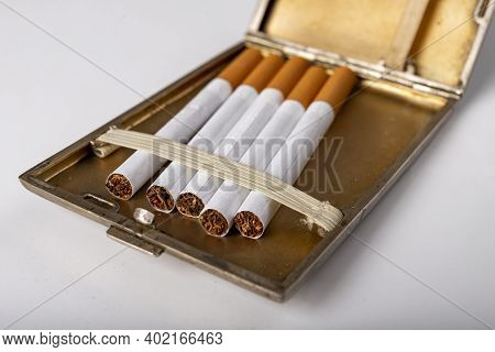 Cigarettes In A Metal Cigarette Case. Stimulants For Adults Dangerous To Health.