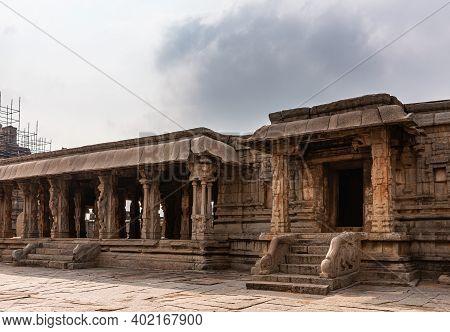 Hampi, Karnataka, India - November 5, 2013: Sri Krishna Temple In Ruins. Brown Stone Baluster Steps
