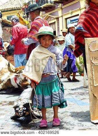 Cuenca, Ecuador - February 22, 2020: Carnival Parade In Cuenca City. Indigenous Village Girl With Ar