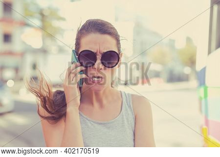 Angry Frustrated Woman Talking Screaming On Phone Outdoors