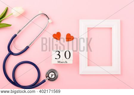 Doctor's Day Concept, Flat Lay Top View, Equipment Medical Red Heart Stethoscope And Photo Frame On