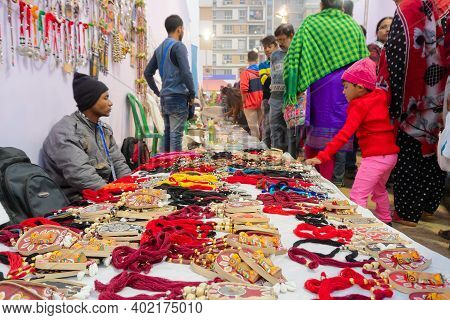 Kolkata, West Bengal, India - 31st December 2018 : Indian Men Selling Coloutful Handmade Jewelleries