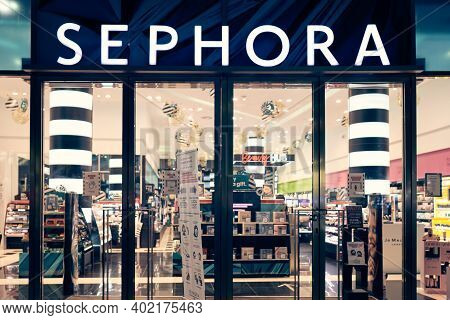 Milan, Italy - 17.12.2020. Sephora Logo And Showcase Of The Store At Night With Christmas Decoration
