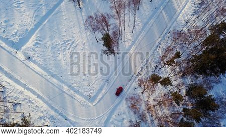 Top View Of Car On Suburban Winter Road. Action. Red Car Is Parked At Intersection Of Roads Marked I