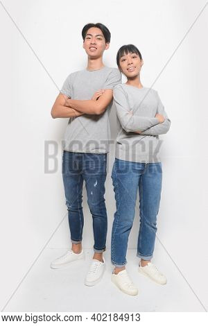 Young couple posing on a white background.  romantic couples in love meet,