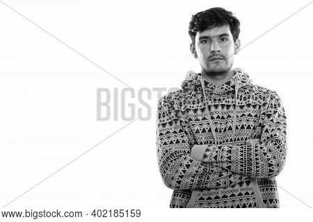 Studio Shot Of Young Persian Man With Arms Crossed