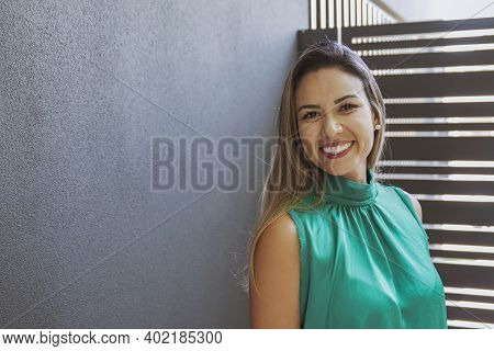 Portrait Of Beautiful Happy And Healthy Middle Aged Brazilian Woman Smiling With Confidence, Busines