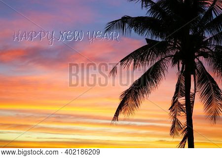 Flame Red Orange Yellow Sky Silhouette And Happy New Year Text In Sunset Back On Coconut Tree