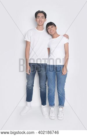 Loving couple posing on a white background.  romantic couples in love meet,