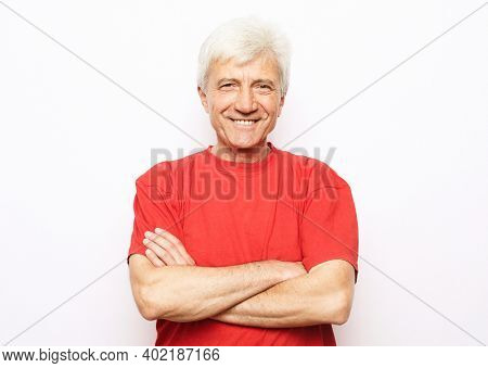 Portrait of healthy happy smile senior elderly caucasian old arm crossed with copy space isolated on white. Golden age healthcare cheerful lifestyle freedom relax retirement concept