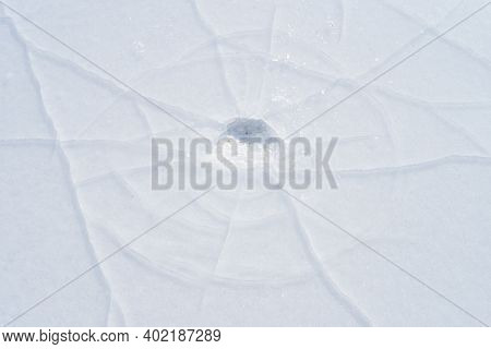 Cracks In The Ice Of A Frozen River In Winter