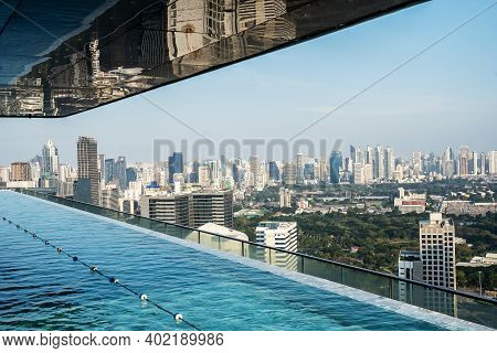 The Swimming Pool Is In A High Rise Condo And With Beautiful Cityscape