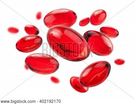 Red Capsules Levitate On A White Background