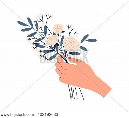 Female Hand Holding Bouquet Of Delicate White Roses And Green Twigs Of Eucalyptus Isolated On White