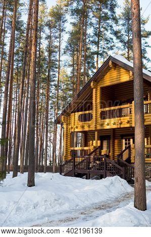 Winters Tale. Finnish Cottage In A Beautiful Snow Forest.wooden Country House Cottage In Winter Pine