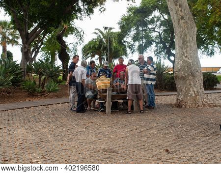 Funchal, Madeira, Portugal - September 4, 2016: Members Of A Local Community Enjoy An Card Game Near