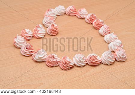 White And Pink Meringues Packed In A Shape Of A Heart