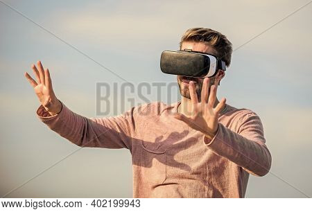 Augmented Reality. Virtual Reality. Cyber Space. Game Online. Man Wear Wireless Vr Glasses Headset.