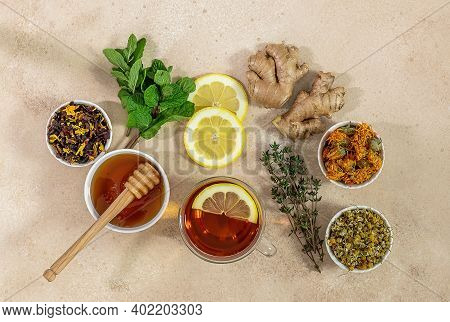 Cup Of Freshly Brewed Fruit And Herbal Tea With Mint, Lemon, And Ginger. Healthy Concept, Remedy For
