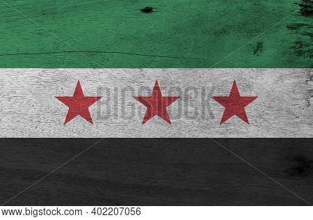 Flag Of Syrian Interim Government On Wooden Plate Background. Grunge Syrian Interim Government Flag
