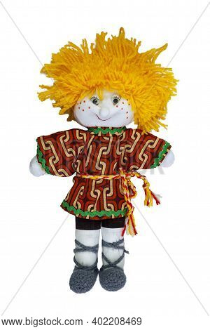 The Doll Is A Boy With Yellow Hair, With A Cheerful Smile. Home Creativity. Traditional Russian Doll