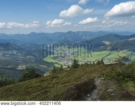 View On Village Liptovska Luzna From Ridge Of Low Tatras Mountains With Mountains, Hills, Meadow And