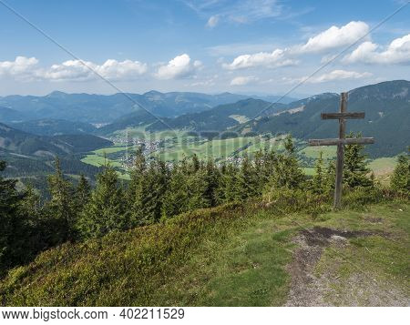 Wooden Double Cross With View On Village Liptovska Luzna At Ridge Of Low Tatras Mountains With Mount