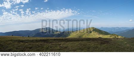 Wide Panorama Of Grassy Green Hills And Slopes At Ridge Of Low Tatras Mountains With Hiking Trail Fo
