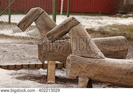 Two Wooden Toy Horses In The Schoolyard