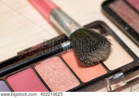 Open Box Of Multicolored Eyeshadow With Makeup Brush