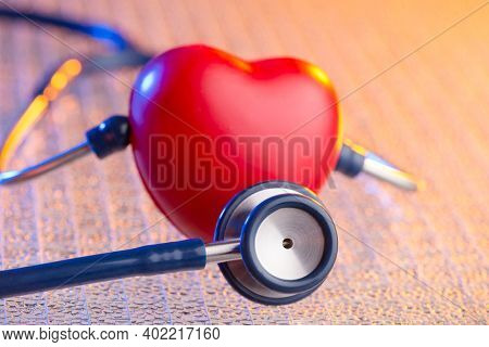 Heart and stethoscope over dramatically lightened background