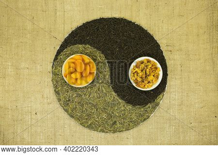 The Concept Of Yin Yang. Sign Yin Yang Against The Background Of Burlap. Chinese Green Tea Lundzyn,