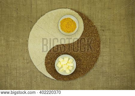 The Concept Of Yin Yang. Sign Yin Yang Against The Background Of Burlap. Rice, Buckwheat, Butter And