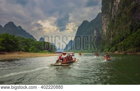 Boats Are Rolling Tourists On The River. The Li River (lijiang) Is Located In Guilin, Guangxi Provin