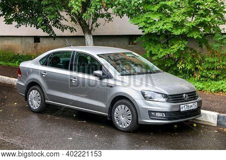 Nizhny Novgorod, Russia - August 13, 2020: Grey Compact Car Volkswagen Polo Sedan In The City Street
