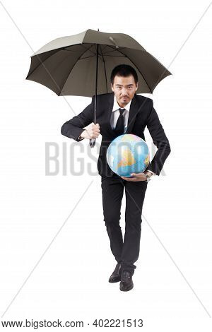Young Businessman Holding Terrestrial Globe And Umbrella High Quality Photo