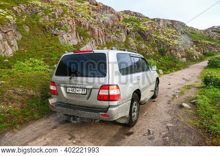 Teriberka, Russia - August 17, 2020: Offroad Car Toyota Land Cruiser 100 At The Rocky Road.
