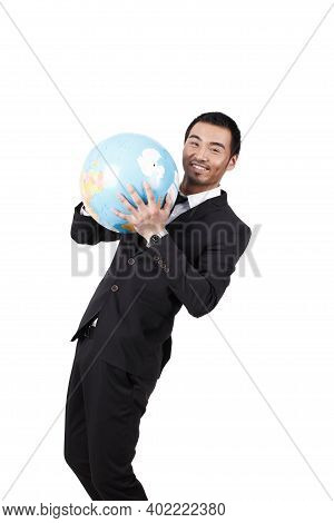 A Young Business Man Holding Terrestrial Globe High Quality Photo