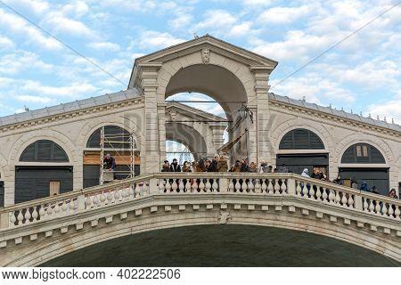 Venice, Italy - January 9, 2017: Tourist Atrraction Rialto Bridge Over Grand Canal At Winter In Veni