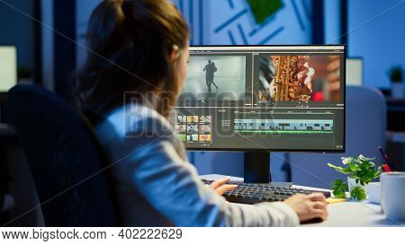Video Editor Working At Night At New Project Editing Audio Film Montage Sitting In Start-up Business