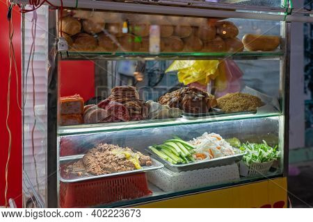 Stall With Traditional Street Food - Banh Mi. Vietnamese National Dish - A Small Baguette With Added