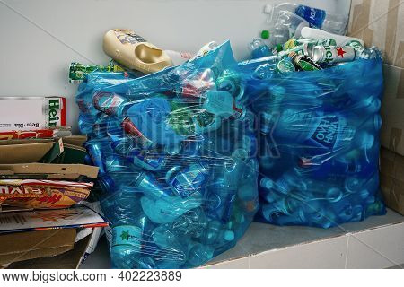 Separately Sorted Waste. Used Plastic Bottles, Metal Cans And Cardboard Packaging Are Collected In W