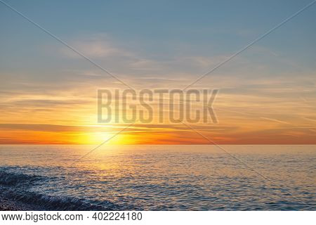 Sunset Over The Sea Horizon.  Sun Goes Down On The Sea. At The End Of The Day, It's Time To Rest And