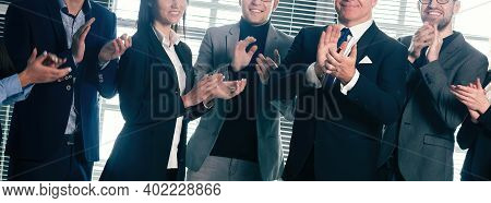 Group Of Happy Employees Applauding Their Success