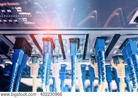 Fiber Optic cables connected to optic ports and Network cables connected to ethernet ports