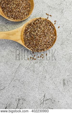 Food Background, Oilseed, Flax Seeds In Two Wooden Spoons, Food Supplement For Digestion, Source Of