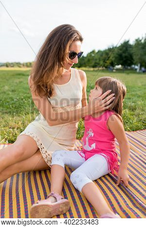 Woman Mother Gives Parting Words To Child, Calms And Talks, Upbringing And Care, In Summer In Park O
