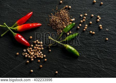 mixed spice and hott chili pepper over black stone