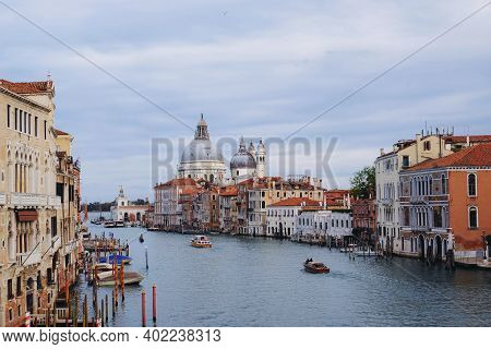 Famous View Of Venice Grand Canal With Saint Mary Of Health Dome On Sunny Day From Ponte Dell'accade